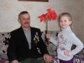 «Цветы  отважному герою». Автор:  Корпусова  Валентина (Грязовецкий район).  Внучка любит дедушку и дарит цветы 15 февраля в день вывода войск из Афганистана.